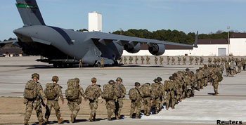 Troops loading up on cargo planes destined for the Middle East