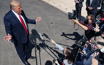 Trump, unlike Biden, takes questions from the press corps
