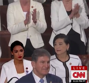 Ocasio-Cortez sits while others stand and applaud President on cooperating and compromisinng