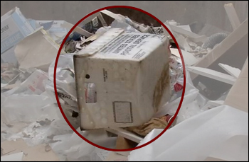 Dumpster with USPS basket and mail ballots