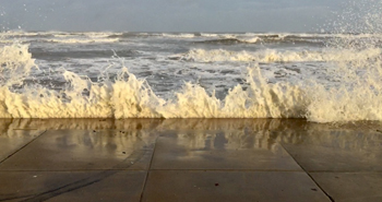 Breakers from Hurricane Laura hit the seawall in Galveston
