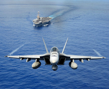 US Aircraft carrier with F-18 Hornet in the foreground