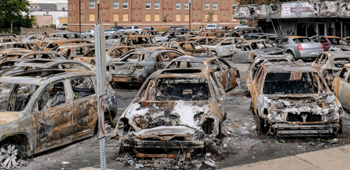 Parking Lot of  burnt cars at dealership