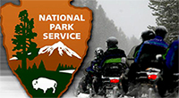 National Park Service Seal with Motorcycle Guests Entering a National Park