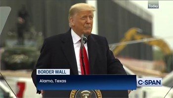 Trump speaks at the border wall that now stretches 450 miles